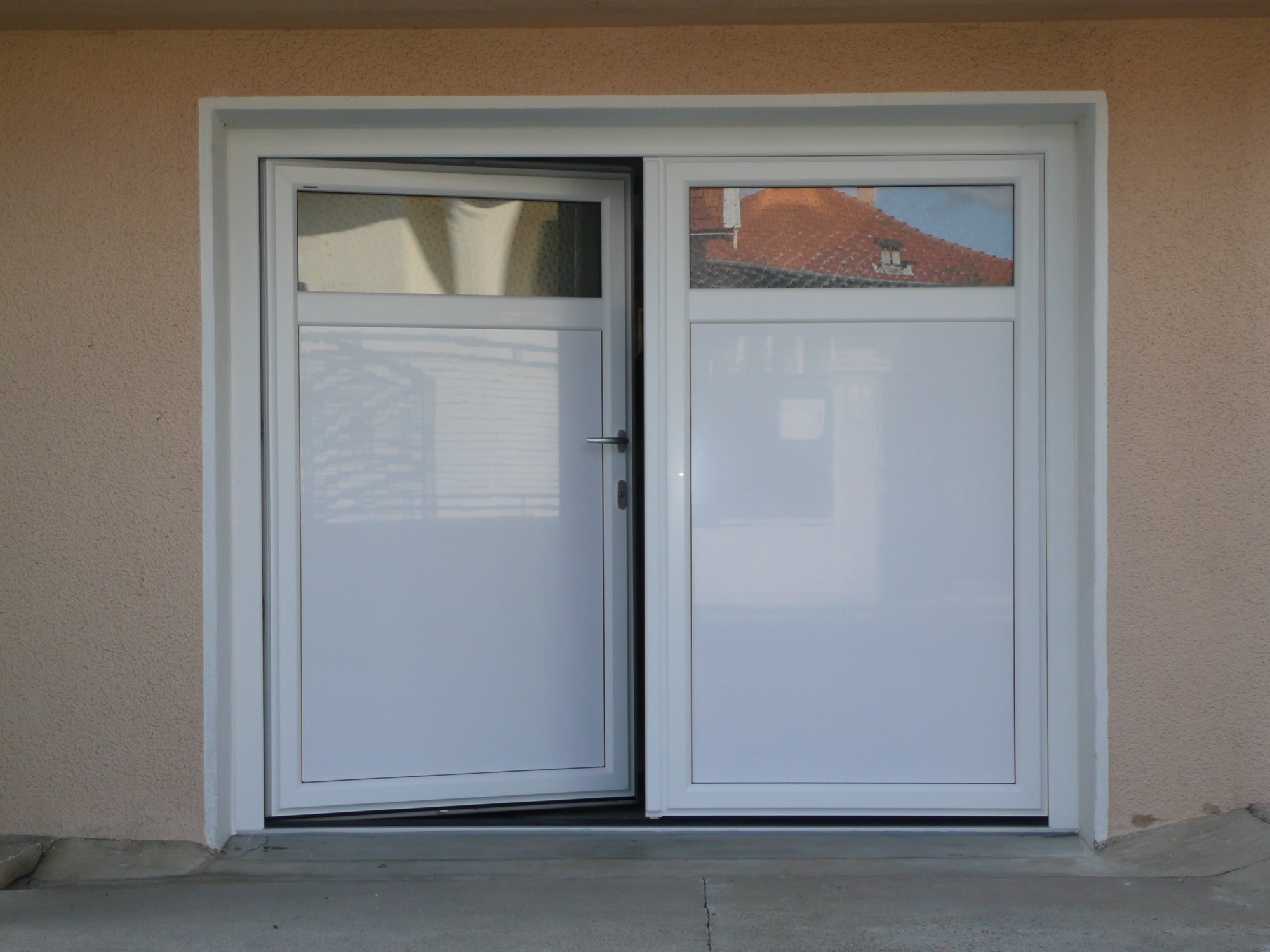 Installateur de portes de garage battantes isol es for Monter porte de garage